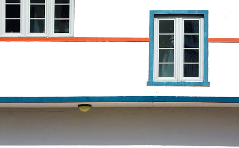 Art Deco Building Architecture red line round window pattern in South Beach Miami Florida