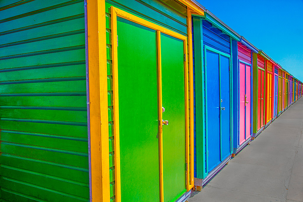 Architecture Bahamas Beach huts row in bright colors fading into the distance