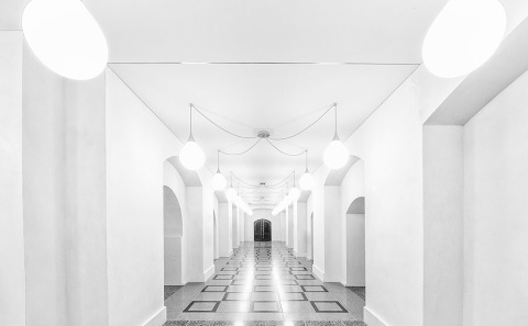 White Hallway Architecture with mosaic tiled floor
