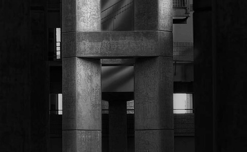 Shadows of Concrete car park pillars and windows in black and white