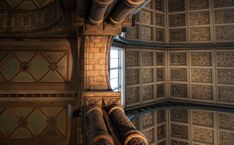 Interior Ornate Carved stone ceiling architecture of Cathedral Church in England