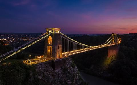 Clifton suspension Bridge Bristol England at sunset with car lights sunset
