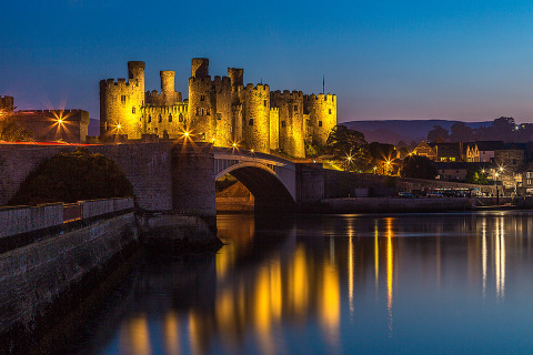 Conwy Castle in North Wales at Night in Lights reflecting in the waters
