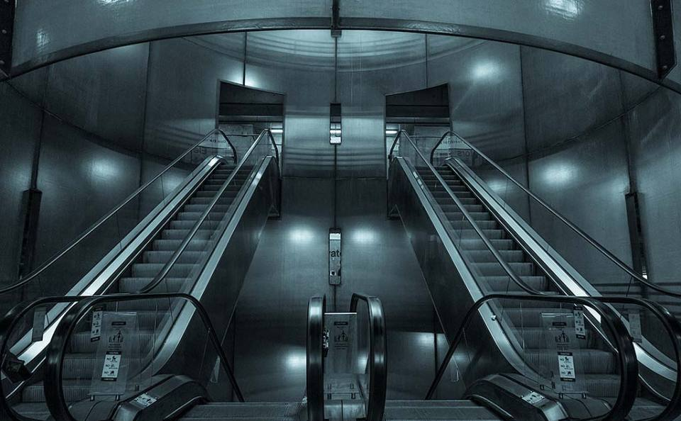 Architecture of modern metal Escalators and steps in train station futuristic design