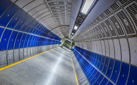 Modern Futuristic architecture Design of London Tube Subways station walkway in metal and blue panels