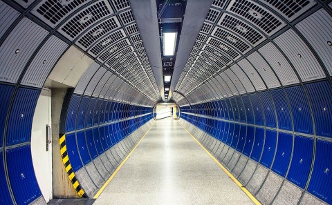 Modern Futuristic architecture Design of London Tube Subways station walkway in metal with doorway
