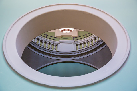 Stone Architecture through Oval window in the Victoria and Albert Museum in London England