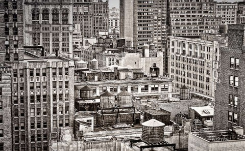Rooftops buildings and water towers in New York City NYC in Black and white