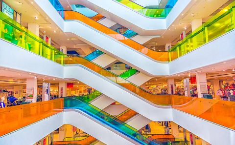 Bright Neon Escalators in shopping centre Peter Jones store in London England