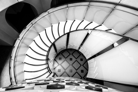 Spiral staircase and Tiled Floor Architecture of the Victoria and Albert Museum in London England