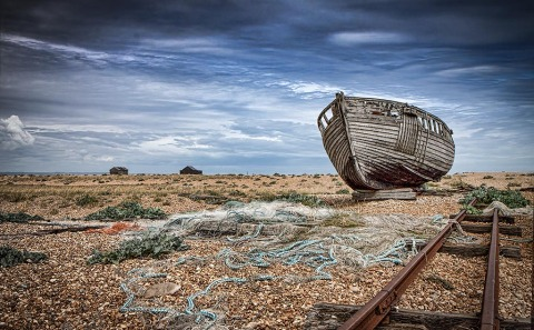 An Old Fishing Boat and nets in Dungeoness Kent in England