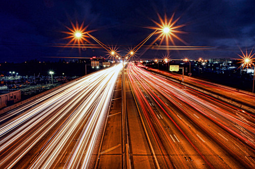 Car Light Trails on the Interstate Freeway at Night with the street lights with star effect