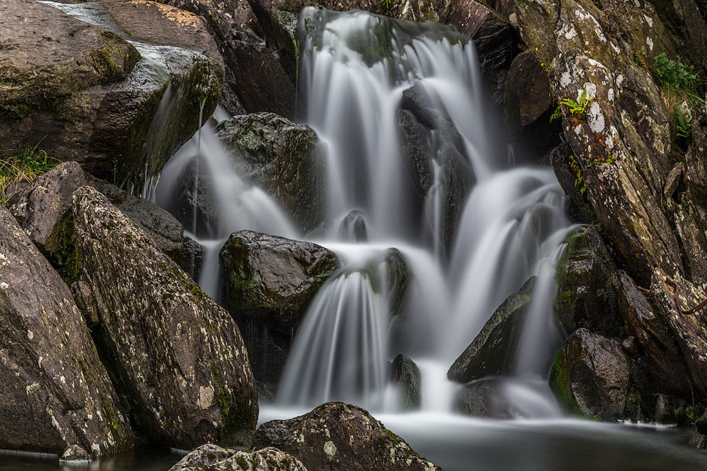 Waterfall Blurred Waters gushing in Snowdonia Wales UK