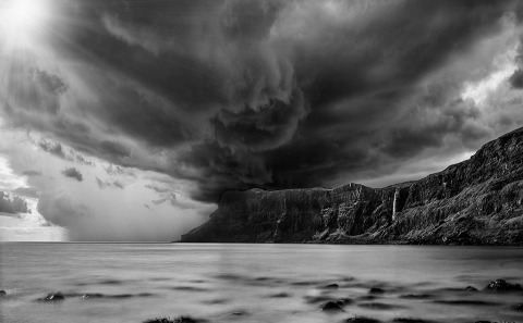 Stormy sky and sunshine at Talisker Bay Beach in Isle of Skye Scotland
