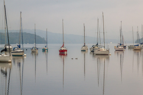 Sail Boats Reflected on the waters Lake Windermere in the English Lake District