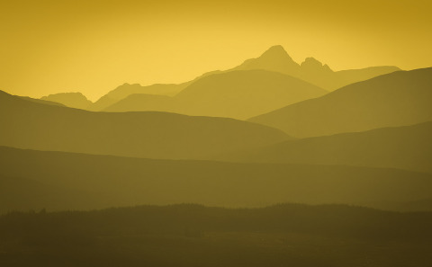 Mountains at Sunset in the golden hues in the distance