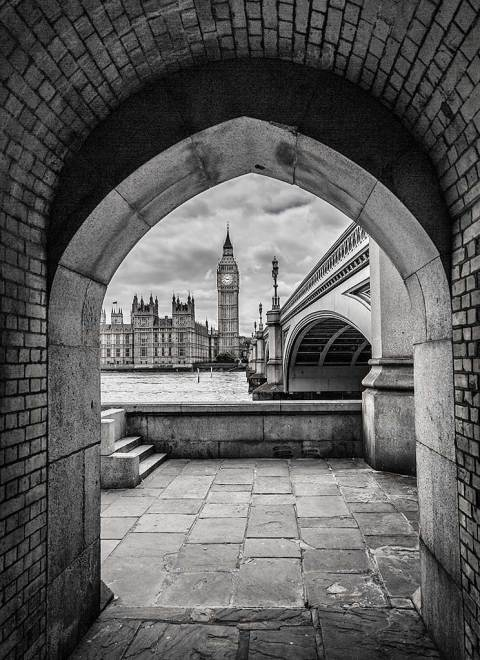 London Big Ben Houses of Parliament and River Thames from under Arch
