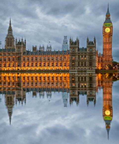 London Big Ben Houses of Parliament Reflected in the River Thames in Lights