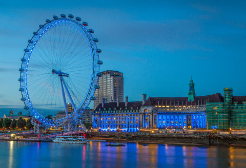 London Eye Wheel at Night on the River Thames in Blue Lights