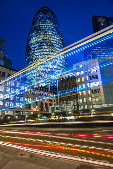London Gherkin Building at Night with Car Light Trails