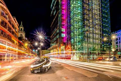 London Heron Tower Black Taxi at Night With Car Trail Lights