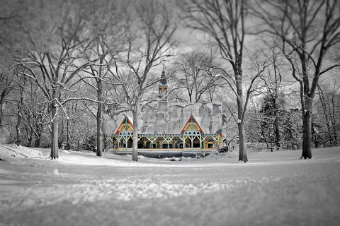 An Old Wooden Chalet in the Snow and surrounded by trees in Central Park in New York City