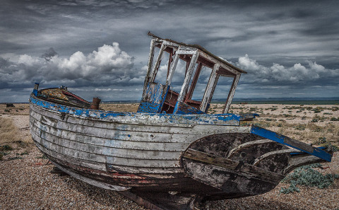 An old derelict Fishing Boat and nets in Dungeoness Kent in England