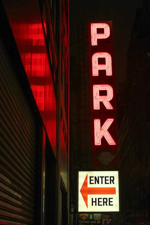 neon parking sign in NYC New York City at night