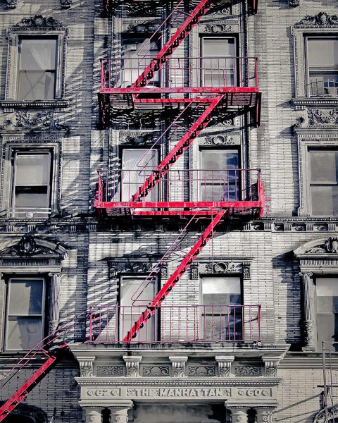 Red Fire Escape on The Manhattan Building top NYC New York City