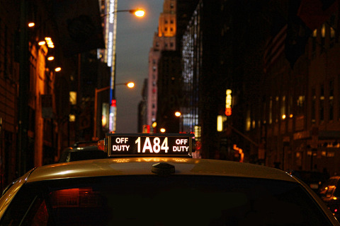Yellow Taxi Cabs in New York City NYC dusk
