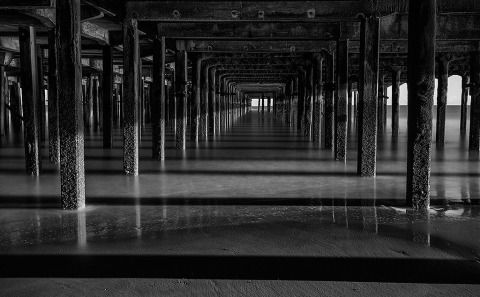 Architecture Under the Pier Jetty in Walton on the Naze in England in Black and White Long Exposure