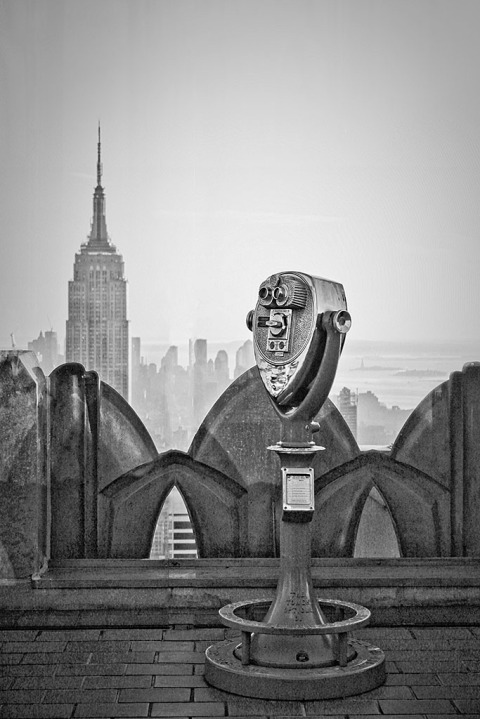 View of Empire State Building and Binoculars Building in NYC New York City in black and white