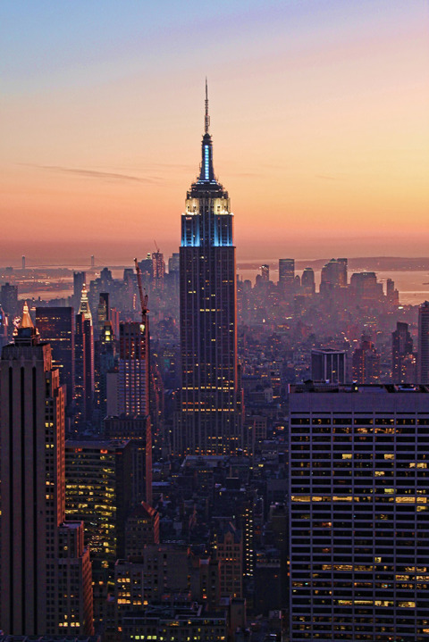 View of the empire State Building at sunset in lights in Manhattan New York City NYC