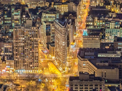 view of the Flatiron Building and midtown manhattan in new york city NYC at night