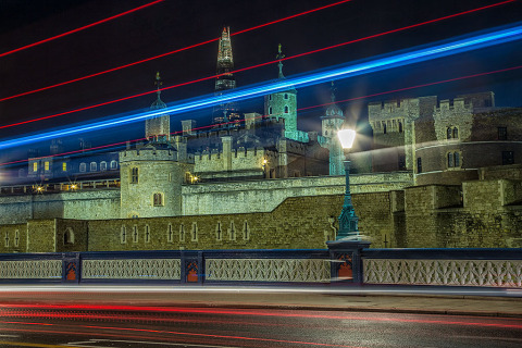 Tower of London in England on Tower Bridge Road with car light trails at night