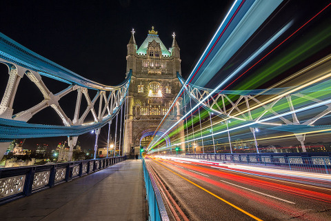London Tower Bridge at night with car and bus light trails