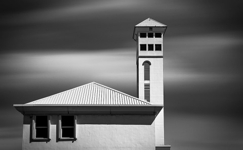 Architecture of building in Nassau in Bahamas long exposure with Clouds in Black and White