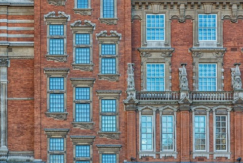 old architectural windows and ornate elements in a red brick building in London