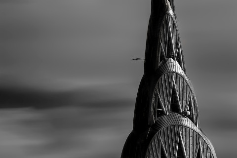 close up of the art deco spire of the chrysler building in Manhattan in new york city in lack and white