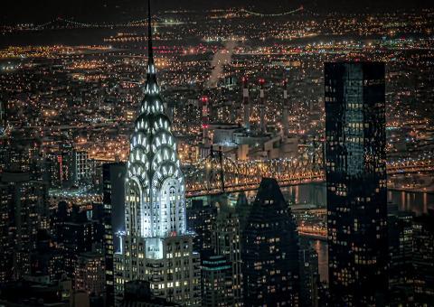 Chrysler building illuminated at night in lights in manhattan NYC New York City