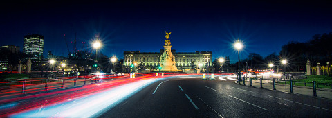 Buckingham Palace and the Victoria Memorial in London England with Car light trails at night panorama