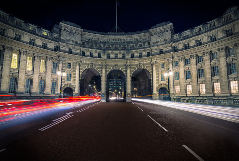 St James Gate Building Architecture in London at night with car Trails