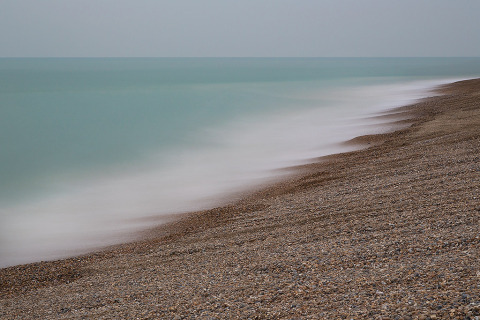 seascape ocean long exposure shoreline stone beach and sea waves