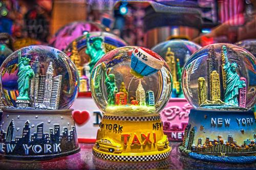colorful snow globes of new york scenes in a toy shop in manhattan
