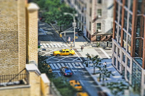tilt shift of a yellow taxi cab in midtown manhattan new york city NYC