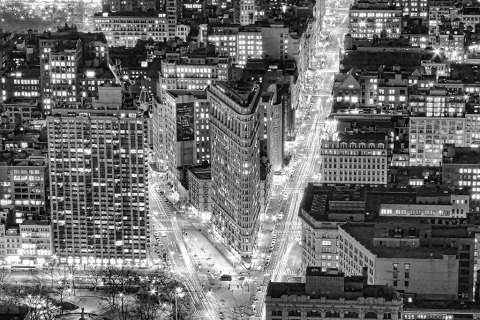 view of the Flatiron Building and midtown manhattan in new york city NYC at night in black and white