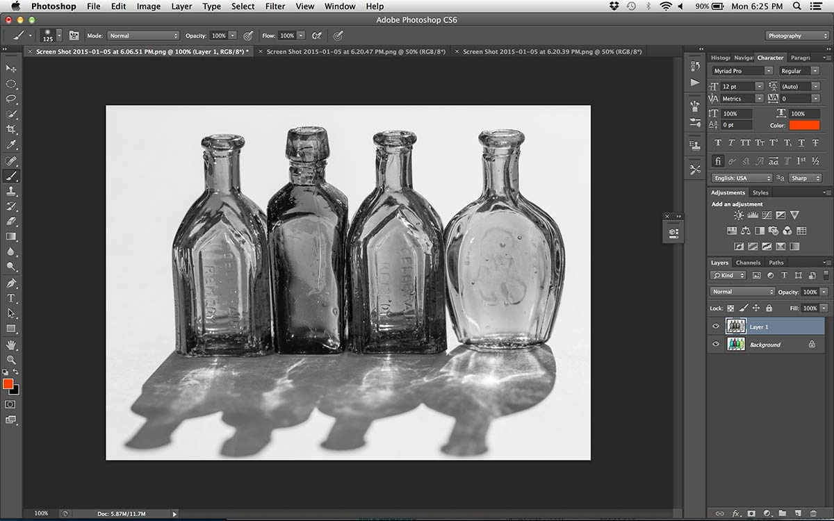 photoshop open image of glass bottles still life converted to black and white