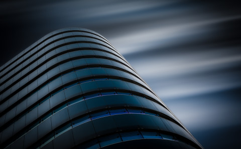 architecture-long-exposure-blue-curve-glass-modern-office-buildings