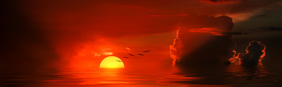 red-sunset-yellow-sun-clouds-pelicans-waterscape