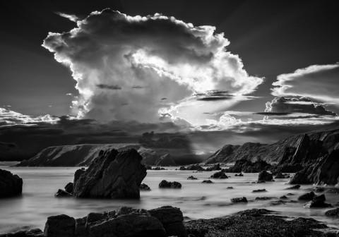 Pembrokeshire-coast-landscape-black-white-sun-beam-clouds